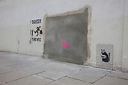 London, UK. Saturday 23rd February 2013. Site of the Wood Green Banksy in North London. The iconic artwork was removed from this site and will go on sale in Miami and is expected to reach an estimated £500,000. Local people are protesting and campaigning to stop the ale.
