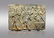 Picture & image of Hittite monumental relief sculpted orthostat stone panel from the Herald's Wall. Basalt, Karkamıs, (Kargamıs), Carchemish (Karkemish), 900-700 B.C. Military parade. Anatolian Civilisations Museum, Ankara, Turkey. Two helmeted soldiers in short skirts carry the shield on their backs and the spears in their hands.  <br /> <br /> Against a gray background. .<br />  <br /> If you prefer to buy from our ALAMY STOCK LIBRARY page at https://www.alamy.com/portfolio/paul-williams-funkystock/hittite-art-antiquities.html  - Type  Karkamıs in LOWER SEARCH WITHIN GALLERY box. Refine search by adding background colour, place, museum etc.<br /> <br /> Visit our HITTITE PHOTO COLLECTIONS for more photos to download or buy as wall art prints https://funkystock.photoshelter.com/gallery-collection/The-Hittites-Art-Artefacts-Antiquities-Historic-Sites-Pictures-Images-of/C0000NUBSMhSc3Oo
