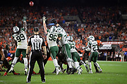 The New York Jets leap in the air while trying to block a successful extra point that gives the Cleveland Browns their 21-17 margin of victory late in the fourth quarter during the 2018 NFL regular season week 3 football game against the New York Jets on Thursday, Sept. 20, 2018 in Cleveland. The Browns won the game 21-17. (©Paul Anthony Spinelli)