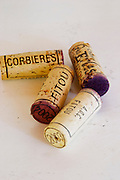 Corks: Corbieres, Fitou, 2004, 2003. Chateau des Erles. In Villeneuve-les-Corbieres. Fitou. Languedoc. Handful of corks on a table. France. Europe.