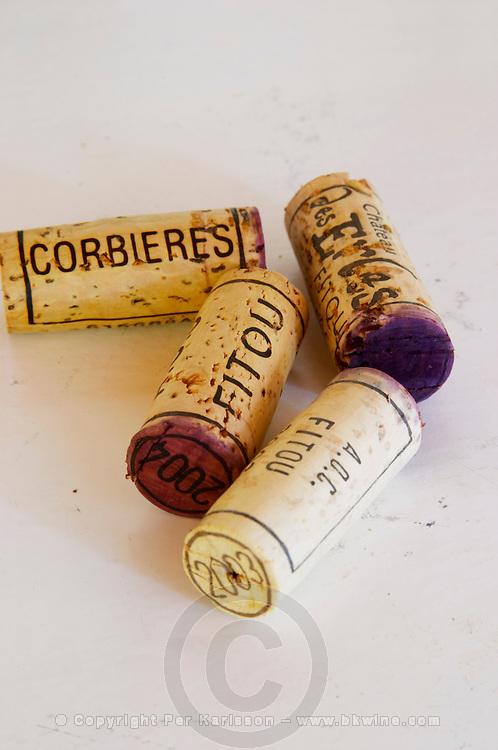 Corks: Corbieres, Fitou, 2004, 2003. Chateau des Erles. In Villeneuve-les-Corbieres. Fitou. Languedoc. Handful of corks on a table. France. Europe.