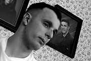 A photo of Toben Medeiros, 21 hangs on the wall in the background taken before he enlisted.  Toben Medeiros, 21 tries to come to grips with his injuries as he adapts to a little bit of life at home before going for more treatment in Washington D.C. Toben is a marine from Dartmouth, MA that was wounded during a tour of duty in Iraq when a roadside bomb exploded while his squad attempted to flee a building that was under enemy fire.  His best friend was killed instantly.