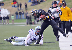 Nov 13, 2010; Columbia, MO, USA; Missouri Tigers running back De'Vion Moore (26) runs for yardage as Kansas State Wildcats cornerback Tysyn Hartman (2) forces Moore out of bounds in the second half at Memorial Stadium. Missouri won 38-28.  Mandatory Credit: Denny Medley-US PRESSWIRE