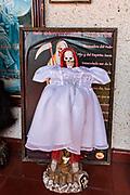 A shrine and offerings to the White Lady inside the La Casa De La Santa Muerte or House of the Saint of the Dead November 1, 2017 in Santa Ana Chapitiro, Michoacan, Mexico.