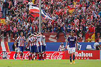 Atletico de Madrid´s players celebrate a goal during 2014-15 La Liga Atletico de Madrid V Espanyol match at Vicente Calderon stadium in Madrid, Spain. October 19, 2014. (ALTERPHOTOS/Victor Blanco)