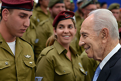 SHIMON PERES (2 August 1923 - 28 September 2016) was a Polish-born Israeli statesman. Born Szymon Perski, he was the ninth President of Israel from 2007 to 2014, served twice as the Prime Minister of Israel and twice as Interim Prime Minister, and he was a member of 12 cabinets in a political career spanning over 66 years. Peres won the 1994 Nobel Peace Prize together with Yitzhak Rabin and Yasser Arafat for the peace talks that he participated in as Israeli Foreign Minister, producing the Oslo Accords. PICTURED: May 1, 2014 - Jerusalem, Israel - President SHIMON PERES of Israel speaks with soldiers during preparations for celebrations of Israel's Independence Day. (Credit Image: © Kobi Gideon/Xinhua/ZUMAPRESS.com)