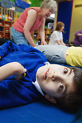 Disabled child having foot massage,