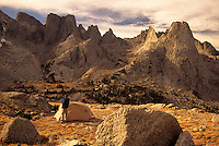 A young man camps below the Cirque of the Towers in the Wind River Mountains, Wyoming.