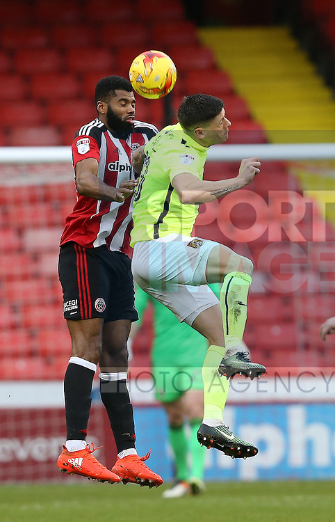 Ethan Ebanks-Landell of Sheffield Utd tussles with Alex Revell of Northampton during the English League One match at Bramall Lane Stadium, Sheffield. Picture date: December 31st, 2016. Pic Simon Bellis/Sportimage