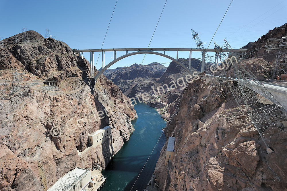 Mike Ocallaghan - Pat Tillman Memorial Bridge at Hoover Dam. <br /> <br /> Hoover Dam is designed to never have the water level of Lake Mead overtop the dam. There are spillways on each side which route excess storage around the dam.