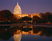 United States Capitol Building with Reflecting Pool at dusk, Washington, District of Columbia.
