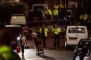 A family is seen collecting their children and leaving the neighbourhood for the time being from the Dale Close Road, in Barnet, North London on late Wednesday, Sept 23, 2020, after several police officers have been injured by a chemical substance while carrying out a drugs raid in north London. (VXP Photo/ Vudi Xhymshiti)