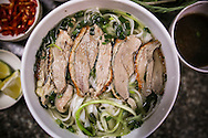 """Traditional vietnamese dish """"pho vit quay"""", an alternative of the classic """"pho"""" noodle soup, served here with duck. Hanoi, Vietnam, Southeast Asia"""