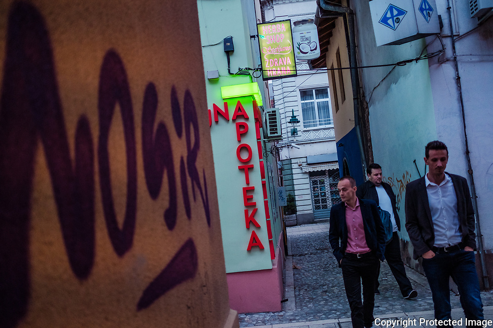 Three men walk through the narrow streets of  Sarajevo's Old Town (Baščaršija). Truly the pulse of the city the Old Town is home to mosques, churches, restaurants, shops and a bustling tourist trade.