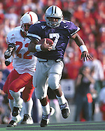 Kansas State quarterback Michael Bishop (7) rushes up field against Nebraska at KSU Stadium in Manhattan, Kansas in 1998.