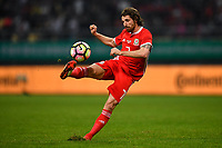 """Joe Allen of Wales national football team kicks the ball to make a shoot against Uruguay national football team in their final match during the 2018 Gree China Cup International Football Championship in Nanning city, south China's Guangxi Zhuang Autonomous Region, 26 March 2018.<br /> <br /> Edinson Cavani's goal in the second half helped Uruguay beat Wales to claim the title of the second edition of China Cup International Football Championship here on Monday (26 March 2018). """"It was a tough match. I'm very satisfied with the result and I think that we can even get better if we didn't suffer from jet lag or injuries. I think the result was very satisfactory,"""" said Uruguay coach Oscar Tabarez. Wales were buoyed by a 6-0 victory over China while Uruguay were fresh from a 2-0 win over the Czech Republic. Uruguay almost took a dream start just 3 minutes into the game as Luis Suarez's shot on Nahitan Nandez cross smacked the upright. Uruguay were dealt a blow on 8 minutes when Jose Gimenez was injured in a challenge and was replaced by Sebastian Coates. Inter Milan's midfielder Matias Vecino of Uruguay also fired at the edge of box from a looped pass but only saw his attempt whistle past the post. Suarez squandered a golden opportunity on 32 minutes when Ashley Williams's wayward backpass sent him clear, but the Barca hitman rattled the woodwork again with goalkeeper Wayne Hennessey well beaten."""