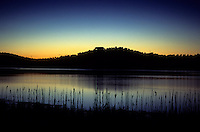 A Colorado lakehouse is silhouetted at dusk.