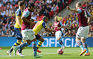 Arsenal's Theo Walcott attacks the Villa goal during the The FA Cup match between Arsenal and Aston Villa at Wembley Stadium, London, England on 30 May 2015. Photo by Phil Duncan.