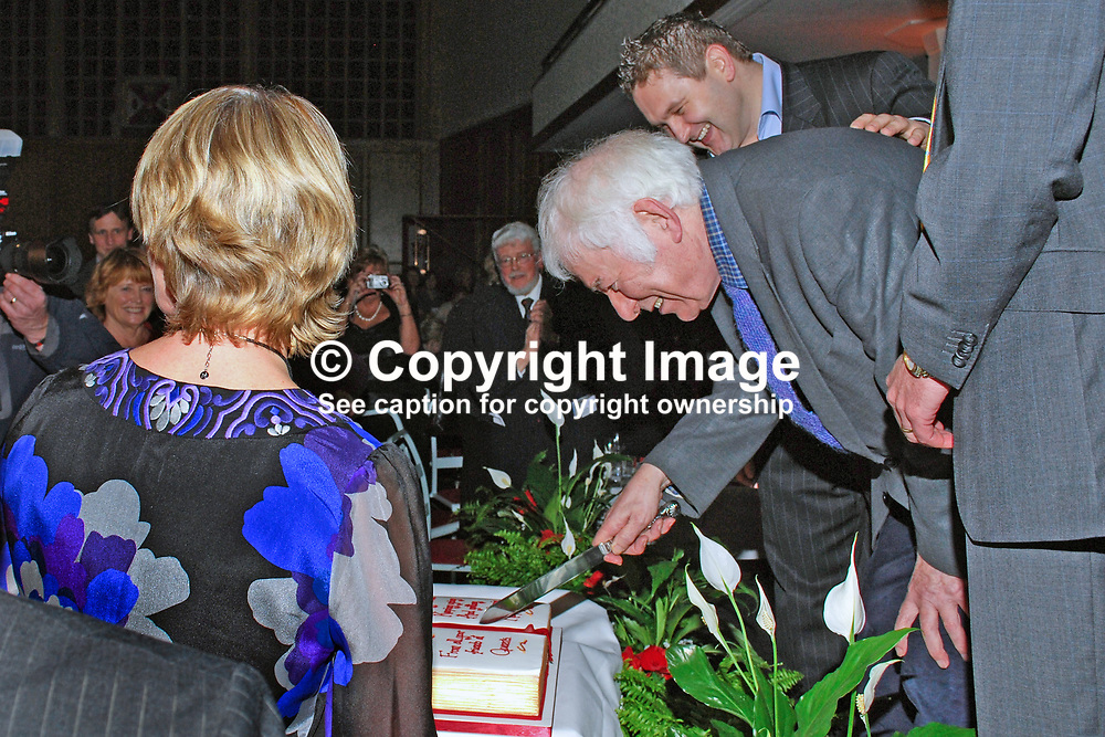 Nobel Laureate Seamus Heaney who is this year celebrating his 70th birthday ceremonially cuts a birthday cake, a gesture from his friends at Queen's University, Belfast, where he was a lecturer in Modern English Literature during the 60's. The occasion was a lunch followed by Heaney being interviewed by broadcaster William Crawley, also in the photograph. 200912023162.<br /> <br /> Copyright Image from Victor Patterson, Belfast, UK<br /> <br /> t: +44 28 9066 1296 (from Rep of Ireland 048 9066 1296)<br /> m: +44 7802 353836<br /> e: victorpattersonbelfast@gmail.com<br /> <br /> www.images4media.com<br /> <br /> Please see my full Terms and Conditions of Use at https://www.images4media.com/p/terms-conditions - it is IMPORTANT that you familiarise yourself with them.<br /> <br /> Images used online incur an additional cost. This cost should be agreed in writing in advance. Online images must be visibly watermarked i.e. © Victor Patterson or that of the named photographer within the body of the image. The original metadata must not be deleted from images used online.<br /> <br /> This image is only available for the use of the download recipient i.e. television station, newspaper, magazine, book publisher, etc, and must not be passed on to a third party. It is also downloaded on condition that each and every usage is notified within 7 days to victorpattersonbelfast@gmail.com.<br /> <br /> The right of Victor Patterson (or the named photographer) to be identified as the author is asserted in accordance with The Copyright Designs And Patents Act (1988). All moral rights are asserted.
