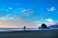 Haystack Rock on Oregon's Cannon Beach is one of the world's biggest sea stacks  and is a must-see on one of the most amazing coastlines in the world, just at the perfect moment of low tide, sunset and as a storm was coming in at full speed!