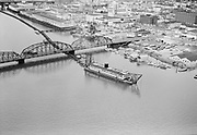 "Ackroyd 06125-2. ""Port of Portland. Dredge working in Willamette river between Hawthorne and old Morrison bridge. June 16, 1955"" (shows east side waterfront)"