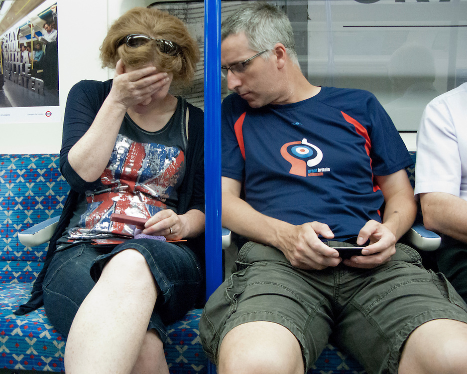 Couple travelling on the London Underground Network