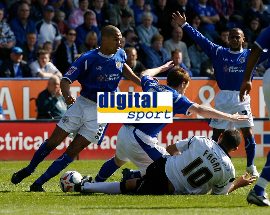 Photo: Steve Bond.<br />Leicester City v Derby County. Coca Cola Championship. 06/04/2007. Craig Fagan (R ground) fouls Leicester's Alan Maybury (C)