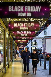 © Licensed to London News Pictures. 28/11/2019. LONDON, UK. Shoppers outside the House of Fraser department store which is promoting discounts in Oxford Street, the capital's busiest shopping area, on the eve of Black Friday.  The US phenomenon of discounts for Thanksgiving has now been adopted by many retailers in the UK with several offering discounts during the prior week, instead of on the day itself.  Critics question whether some discounts offered on the day are cheaper than at other times.  Photo credit: Stephen Chung/LNP