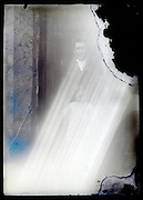 deteriorating glass plate photo of father with child