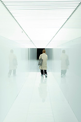"""© Licensed to London News Pictures. 17/05/2021. LONDON, UK. A woman walks through """"spectra III"""", 2008/19 by Royji Ikeda,  Preview of Ryoki Ikeda's exhibition at 180 The Strand, the largest ever European exhibition of the Japanese artist's work.  Twelve audio-visual digital artworks, five of which have never been seen before, are on show 20 May to 1 August 2021.  Photo credit: Stephen Chung/LNP"""
