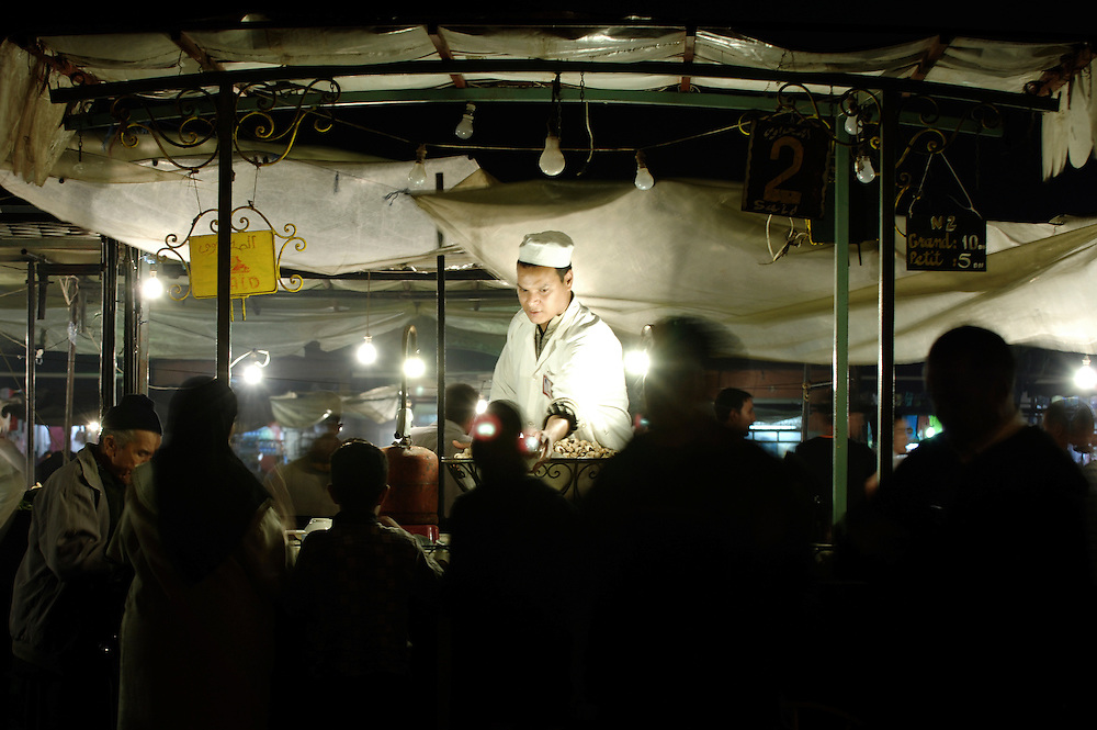 """Marrakech, Morocco 02 November 2006<br /> """"Djemaa-el-Fna"""" square. <br /> Snake charmers, story tellers, street artists, orange juice stands, ambulant restaurants, Coran readers and souvenir shops meet up and bring life to the place every day.<br /> Photo: Ezequiel Scagnetti"""