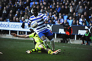 Yeovil Town's Kieffer Moore tackles Royston Drenthe of Reading(front) for the ball during the Skybet championship match, Reading v Yeovil Town at the Madejski Stadium in Reading, Berkshire on Saturday 1st March 2014.<br /> pic by Jeff Thomas, Andrew Orchard sports photography.