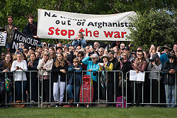 Anti war protestors among crowds waiting to see the Duke and Duchess of Sussex during a public walkabout on a visit to the newly unveiled UK war memorial and Pukeahu National War Memorial Park, in Wellington, on day one of the royal couple's tour of New Zealand.