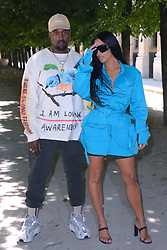 "File photo of Kanye West and Kim Kardashian attending the Louis Vuitton Menswear Spring Summer 2019 show as part of Paris Fashion Week in Paris, France on June 21, 2018. Kim Kardashian West spoke out about Kanye West's bipolar disorder Wednesday, three days after the rapper delivered a lengthy monologue at a campaign event touching on topics from abortion to Harriet Tubman, and after he said he has been trying to divorce her.Kardashian West said in a statement posted in an Instagram Story that she has never spoken publicly about how West's bipolar disorder has affected their family because she is very protective of their children and her husband's ""right to privacy when it comes to his health."" Photo by Aurore Marechal/ABACAPRESS.COM"
