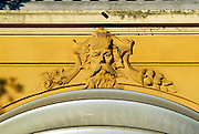 Detail of building facade, with male face in bas relief. Opatija, Croatia