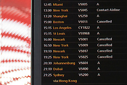 © licensed to London News Pictures. London, UK 29/10/2012. A flight information screen indicating the cancelation of flights to the east American coast from Heathrow Airport at Heathrow Terminal 3 due to Hurricane Sandy. Photo credit: Tolga Akmen/LNP