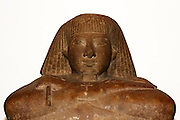 Egyptian block statue of Teti. 18th Dynasty (approx. 1450 BC), probably from Karnak. Teti shown seated on a matt with his feet and arms protruding from a leopard skin coat.