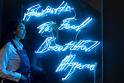 "© Licensed to London News Pictures. 01/10/2018. LONDON, UK. A staff member views ""Fantastic To Feel Beautiful Again"", 1997, by Tracey Emin (Est. GBP40,000 - 60,000). Preview of artworks in Sotheby's Frieze sales at Sotheby's New Bond Street.  The auction will take place 5 October during Frieze and Frieze Masters – the world's most vibrant Contemporary and Modern art fairs.  Photo credit: Stephen Chung/LNP"