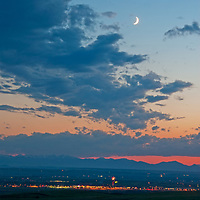 The moon hovers over Bozeman, Montana and the Gallatin Valley on the Fourth of July