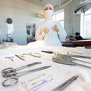 CAPTION: Surgical nurse Irina Shukova prepares to get the surgical instruments ready for the surgeons' next cleft lip correction operation. LOCATION: Volgograd City Hospital #1, Volgograd, Russia. INDIVIDUAL(S) PHOTOGRAPHED: Irina Shukova (left) and Ksenia Kalashnikova (right).