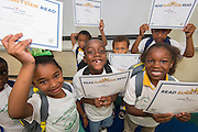 "Students participate in the ""Read Sunnyside Read"" program at Woodson K-8 School, June 11, 2015."