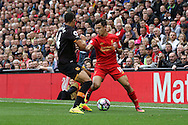 Jake Livermore of Hull City looks to tackle Philippe Coutinho of Liverpool. Premier League match, Liverpool v Hull City at the Anfield stadium in Liverpool, Merseyside on Saturday 24th September 2016.<br /> pic by Chris Stading, Andrew Orchard sports photography.