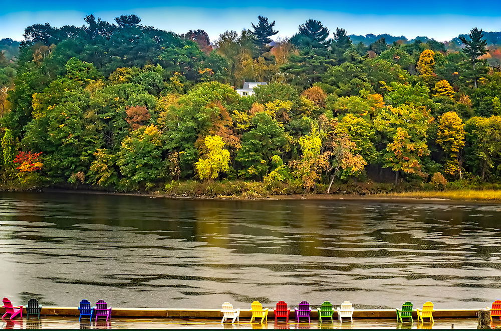 A lineup of chairs along the Kennebec river in Hallowell, Maine