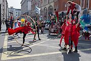Climate Change protesting acrobats with Extinction Rebellion block central London and simultaneously stop traffic across the capital including Marble Arch, Piccadilly Circus, Waterloo Bridge and roads around Parliament Square, on 15th April 2019, in London, England.