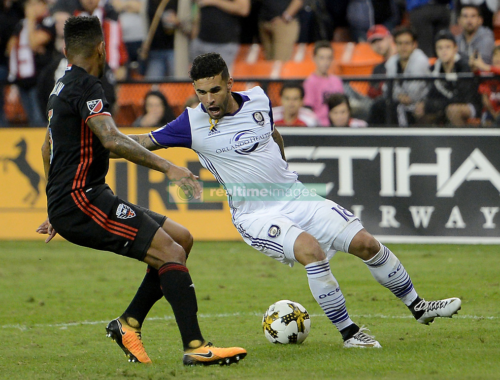 September 9, 2017 - Washington, DC, USA - 20170909 - Orlando City FC forward DOM DWYER (18) adjusts his dribble against D.C. United defender SEAN FRANKLIN (5) in the second half at RFK Stadium in Washington. (Credit Image: © Chuck Myers via ZUMA Wire)
