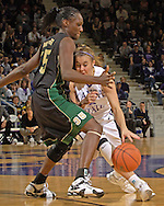 Kansas State's Shalee Lehning (R) tries to drive against pressure from Baylor's Abiola Wabara (L), during the second half at Bramlage Coliseum in Manhattan, Kansas, February 25, 2006. The 10 ranked Lady Bears defeated K-State 79-70.