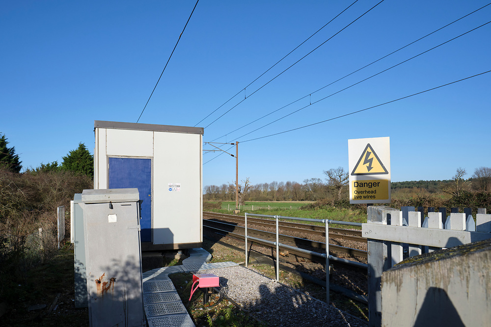 Looking north towards Norwich on the Great Eastern Main Line, Baylham. Signalling & relay box's next to the level crossing.<br /> Photo by Jonathan J Fussell, COPYRIGHT 2020