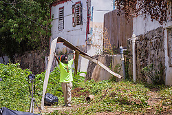 Twaise Carr removes metal from Savan Gut.  Residents and volunteers clean Savan Gut in  preparation for Tropical Storm Danny as a part of Savan CleanUp Day .  St. Thomas, USVI.  22 August 2015.  © Aisha-Zakiya Boyd