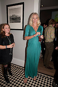 LOUISE THOMAS; JODIE KIDD, Party hosted for ~Jason Wu by Plum Sykes and Christine Al-Bader. Ladbroke Grove. London. 22 March 2011. -DO NOT ARCHIVE-© Copyright Photograph by Dafydd Jones. 248 Clapham Rd. London SW9 0PZ. Tel 0207 820 0771. www.dafjones.com.