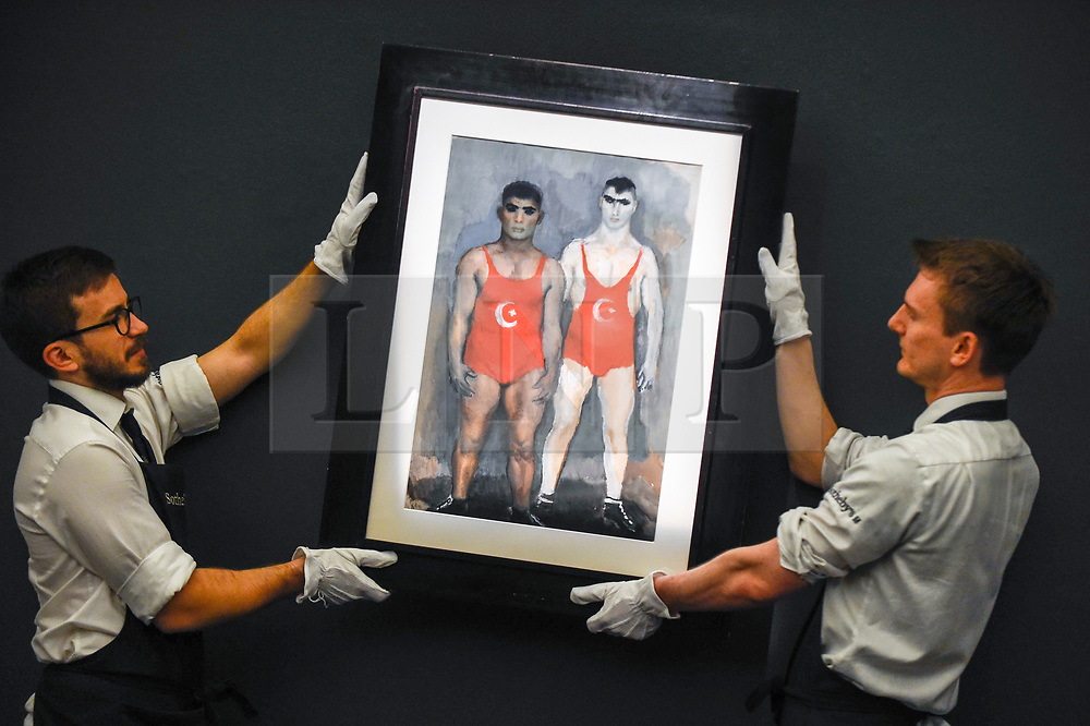 """© Licensed to London News Pictures. 22/11/2019. LONDON, UK. Technicians present """"Wrestlers"""", 1933, by Vladmir Lebedev (Est. GBP30-50k) at the preview for the upcoming sales of Russian artworks at Sotheby's New Bond Street.  The Russian Pictures and Works of Art, Fabergé and Icons sales take place on 26 November.  Photo credit: Stephen Chung/LNP"""